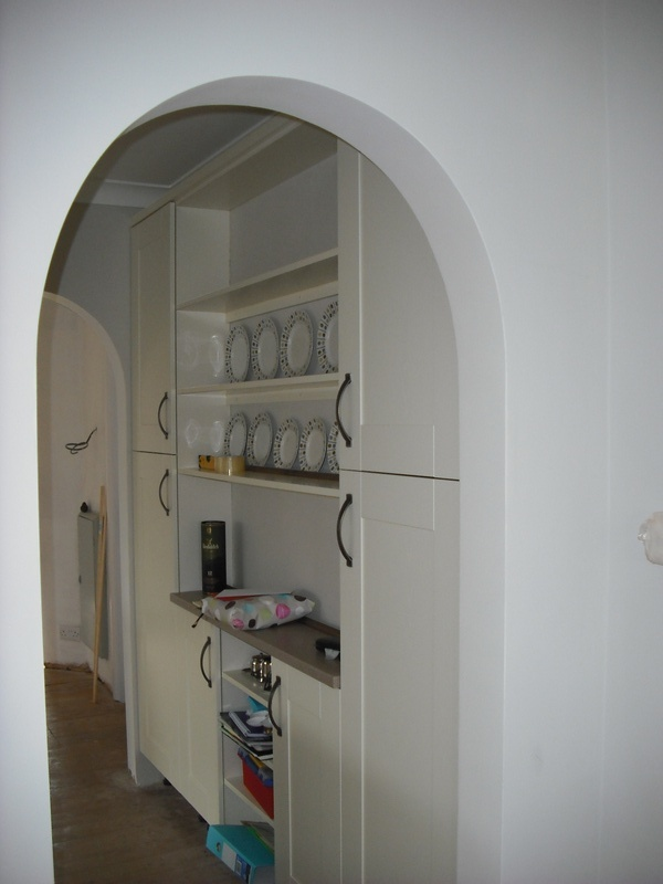 Door removed and arch formed to accommodate  units reduced to 200 mm as dresser.
